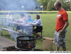 """Members of First Lutheran Church in Newton, Iowa, attend a Tuesday evening worship service in a local park. Since the closing of the town's largest employer and resulting downturn of the congregation, members of First have learned to focus on """"first things"""" — discipleship and mission."""