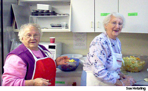 Dorothy Stenger (left) and Margaret Keil prepare a meal to be served at St. Luke Lutheran Church, Valatie, N.Y.