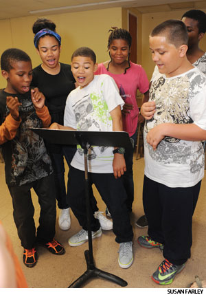 "Sirah Coleman (left), Hannah Watkis, Benjamin Watkis, Dinah Coleman and Carlos Ortiz practice a ""Genesis Rap"" to be performed during Sunday worship at Bridge of Peace."