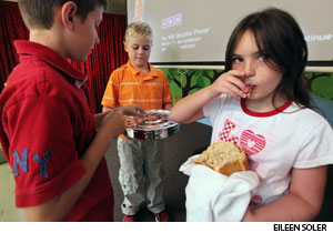 Children serve communion to each other after serving worshipers at Trinity Lutheran Church, Pembroke Pines, Fla., during a weekly intergenerational worship service that doubles as Sunday school.