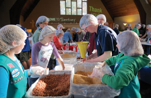 Sanctuary, a relatively new ELCA-Methodist congregation in Marshfield, Mass., emphasizes social service, including gathering folks to package meals for the hungry. Here, the congregation is joined by the youth group from Holy Trinity Lutheran Church, North Easton, Mass.