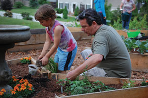 Malachi Martin (left) and Andy Solari work in the church's community garden.
