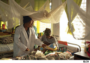 Patients with malaria receive treatment at a hospital ward in Liberia.