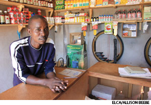 Philliph Choguya works behind the counter at the Chitkete Chemical Supply Shop, which received a startup grant from the Lutheran malaria program in Zimbabwe. The shop sells goods including insecticides for crops and mosquito repellents for neighbors. The proceeds support people affected by malaria.
