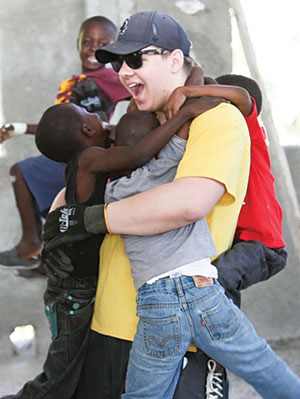 Michael Peterson, a member of Our Saviour Lutheran Church, Naperville, Ill., connects with local children while on a recent mission trip to Haiti.