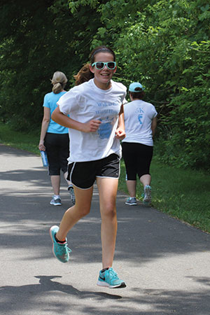 Michelle Shirk Emily Ashly is one of three eighth-graders who organized a 5K walk/run to raise money for a school/hospital in Haiti. Their youth-led Spark Team is one of several at Trinity Lutheran Church, Mount Joy, Pa.