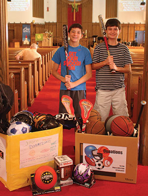 Michelle Shirk Jake Houck (left) and Alex O'Shea led a Spark Team that collected sports equipment for inner-city youth.