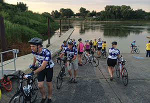 Kyle Pedersen After the traditional dipping of tires in the Missouri River, members of the Lutheran Men in Mission bike team start their ride to the Mississippi River during RAGBRAI, the oldest, largest and longest bike tour.