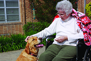 PHOTOS COURTESY OF LUTHERAN SERVICES CAROLINAS Increasingly, science backs up the idea that dogs do make us feel better. Interacting with dogs can help reduce stress, according to research from Kean University School of Nursing, Atlanta. Audine Page pets Rusty.