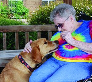 PHOTOS COURTESY OF LUTHERAN SERVICES CAROLINAS Sarah Blalock pets Rusty.