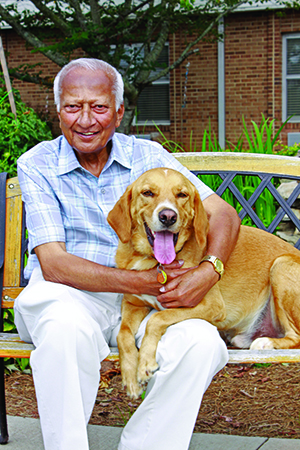 PHOTOS COURTESY OF LUTHERAN SERVICES CAROLINAS Rusty is top dog at Trinity Place in Albemarle, N.C. The 2-year-old dog from the Humane Society makes residents like Jaynata Haldar feel at home at the Lutheran Services of Carolinas-affiliated facility.
