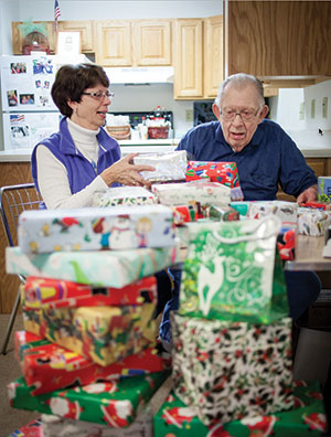 with gifts wrapped fred boettcher and his daughter susan boehm are ready for - Fred Christmas