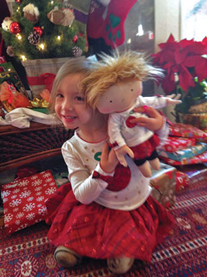 "Ellie is the daughter of Miranda Todd, who said that when her doll arrived from Santa last year: ""I guess Santa knows my hands!"" They live in Texas."