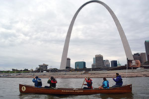 Ricky Taylor Paddlers pause to take in the Gateway Arch as they travel down the Mississippi past St. Louis.