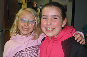 """Katie Barnidge (right), shown with Zoey Kubik, said what she loves most about the program is """"crab soccer, ice cream sandwiches and God."""""""