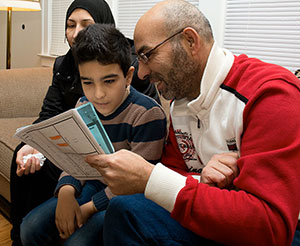 """Dwight Cendrowski Arab (left) — with his father, Buteh — enrolled in public school in December 2015. """"We were worried and thought it will be harder to adjust our life, but so far we are doing good and learning new stuff every day,"""" Buteh said."""