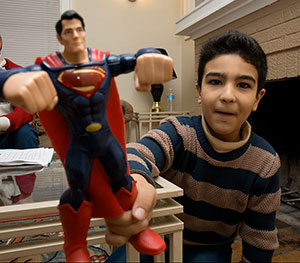 "Dwight Cendrowski Arab, 8, plays with a Superman toy. Originally from Daraa, Syria, his family came to the U.S. ""for a better life,"" his father said. The U.S. government granted them refugee status."