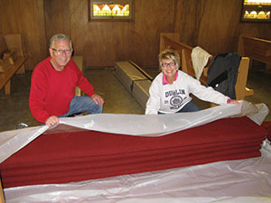 ALYSSA BOOCK Dick and Carolyn Jackson wrap pews from Eidskog Lutheran Church (top photo) in Ortonville, Minn., to be used at the new Hope Lutheran building in River Falls, Wis.