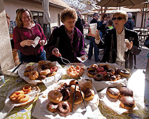 "Dave Nagel Christine Curl (left), Irma Mulder and Faye Phillips partake in treats and coffee during ""Sunday morning hospitality"" at Messiah, which views food as a universal language and offers coffee and doughnuts every week. Some churches have no coffee hour because they view it as too overwhelming for visitors."