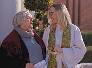 Dave Nagel Angela Denker, a pastor of Messiah, greets Sue Lindemulder after worship. Denker says welcoming is about churches looking for their gifts and picking a niche.