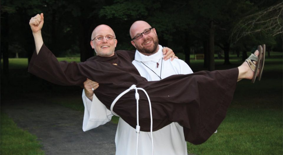 Brother Jeff Steeber, pastor of Christ Lutheran Church, Avon Lake, Ohio, holds Brother Joseph Byrd, Holland, Mich. Steeber is a novice and Byrd is minister of formation for the Order of Lutheran Franciscans.