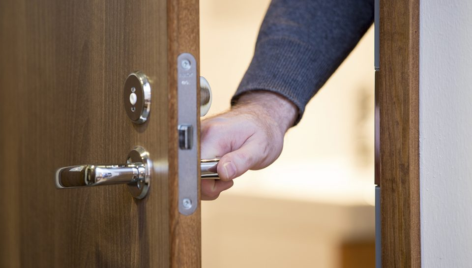 A person opens a door