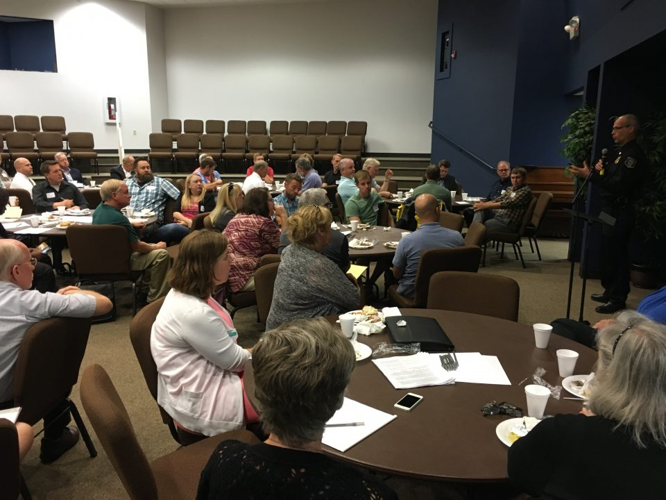 A group of church leaders sit gathered at tables during a luncheon with Empower Sioux Falls.