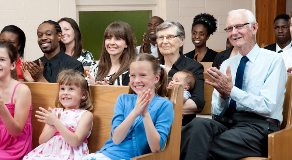 A group of people gathered in church pews
