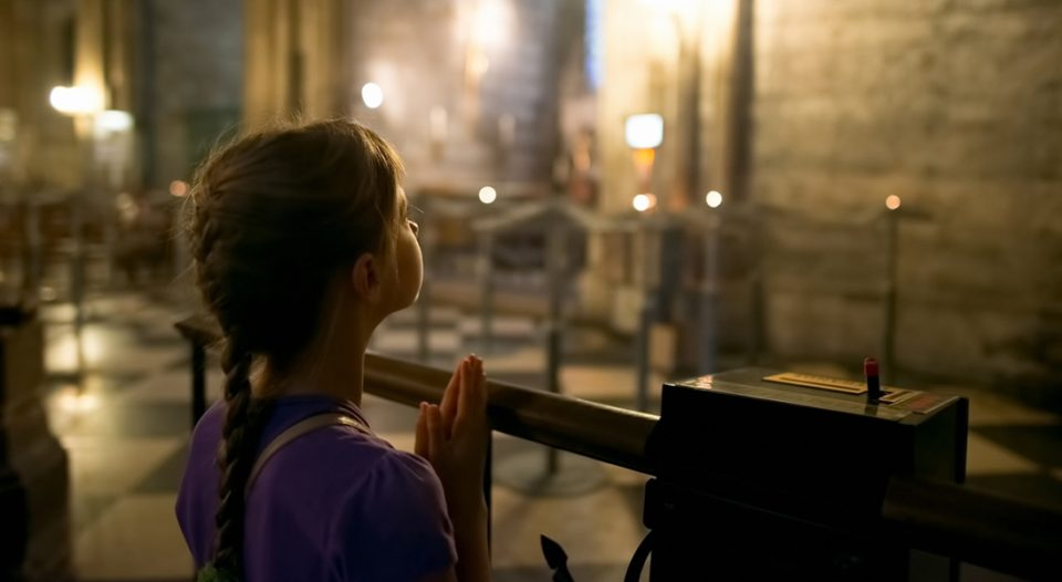 Girl praying at church