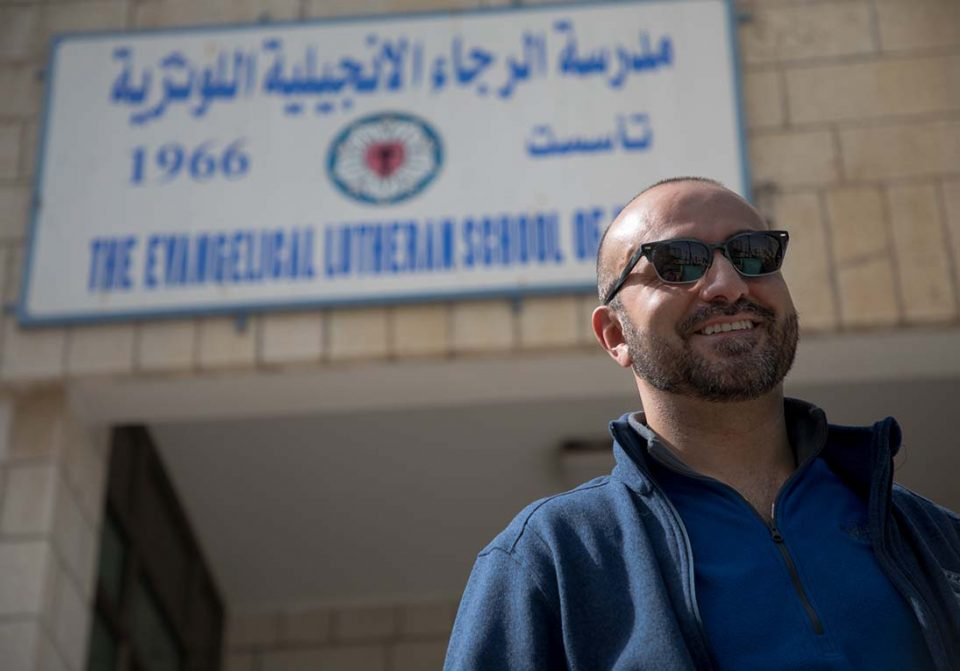Ala, who graduated from the old Evangelical Lutheran School of Hope in Ramallah, stopped in to visit the school during a visit to see his mother in March. Ala now works for the ELCA in Chicago. Photo by Ben Gray / ELCJHL