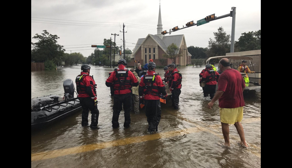 Emergency workers gather at the intersection near Salem Evangelical Lutheran Church in Southwest Houston.
