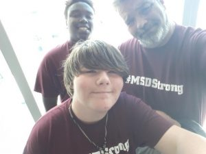 Bruce Elkins, Jamal Jackson and Drew Shimkus take a selfie before beginning their drive to Washington, D.C. to participate in March For Our Lives.