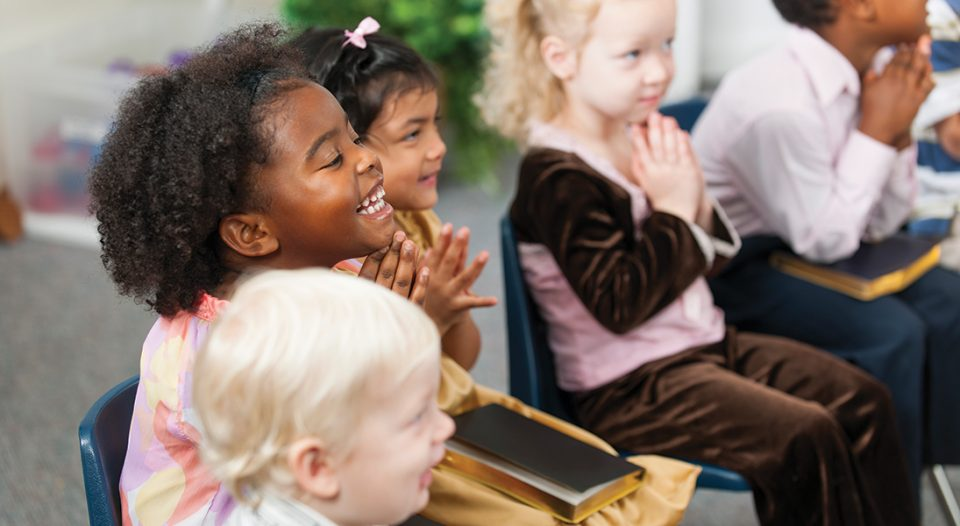 A group of multi-ethnic children at Sunday School in a church classroom