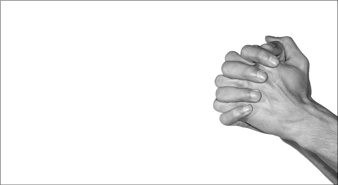 Hands folded in prayer against a white background