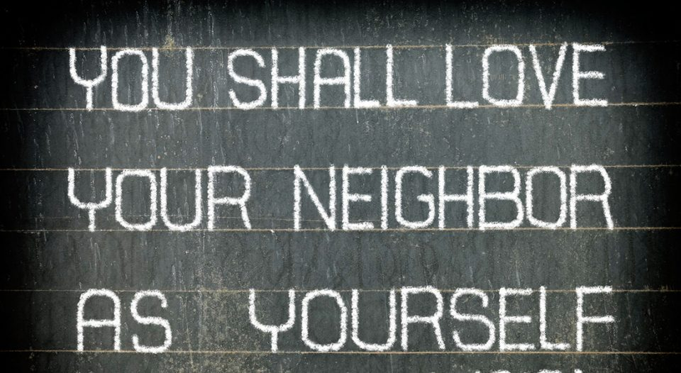 """YOU SHALL LOVE YOUR NEIGHBOR AS YOURSELF"" Bible Verse Chalk Writing on Old Chalkboard Background."