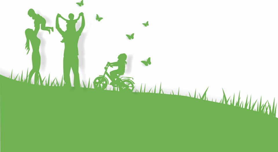 A family silhouetted in green enjoys summer amid a cloud of butterflies.