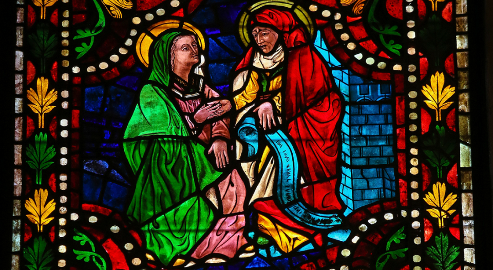 A stained-glass window depicting Mary, the mother of Jesus, and Elizabeth