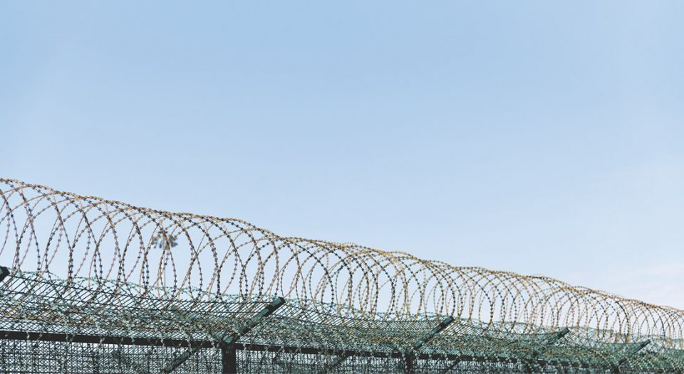 Barbed wire fence at prison