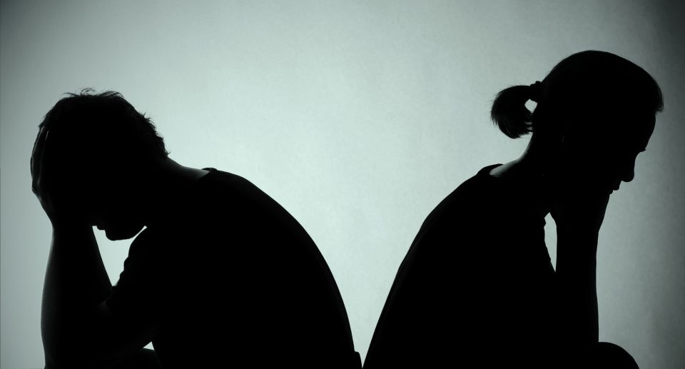Silhouette of a couple back to back